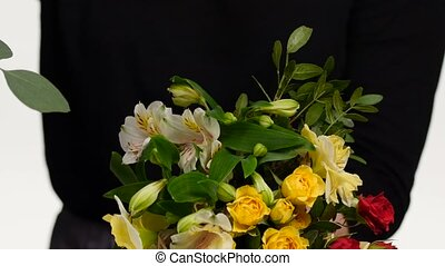 Variety of flowers in the bouquet. Florist. White. Close up...