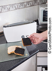 Burning toast - Toasting sandwich bread slices gone wrong