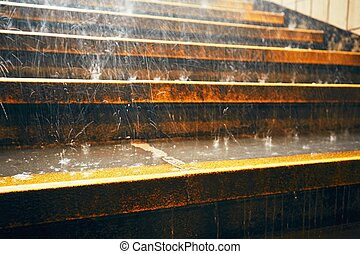 Heavy rain in the city Rain droplets on the staircase during...