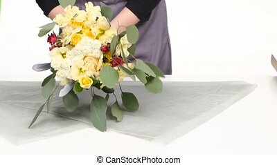 Florist make up the composition of flowers White Close up -...