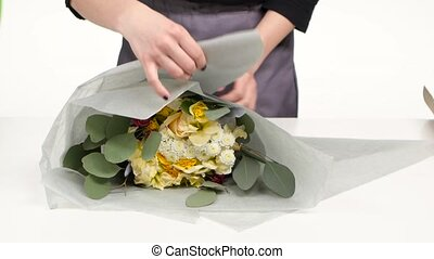 Florist wrapping for bouquet flowers. White. Close up -...
