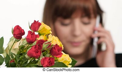 Florist in flower shop Taking order from client by phone...