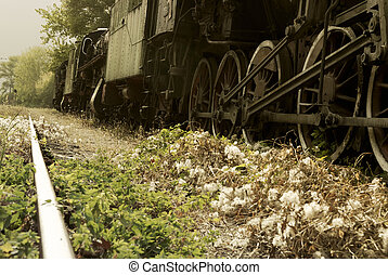 Low angle view of a retro train and railroad tracks for...