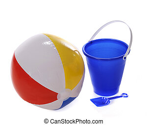 Beach toys - A beach ball with a blue sand pail and shovel...