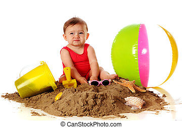 Yucky Sand - An adorable baby girl making a yucky face as...