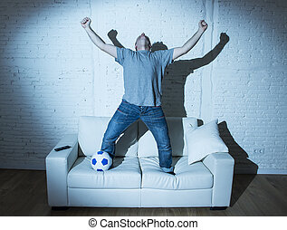 fanatic and crazy football fan watching television soccer...