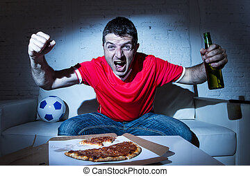 fanatic football fan man watching soccer game on tv...