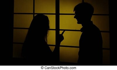 Girl and boy near the window. Silhouette. Close up