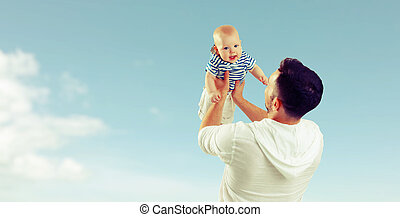 happy family father throw up baby son on sky - happy family...