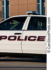 Police car outside of cop shop - A closeup of the...