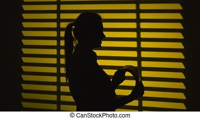 Girl quickly turns the log sheets. Silhouette. Close up -...