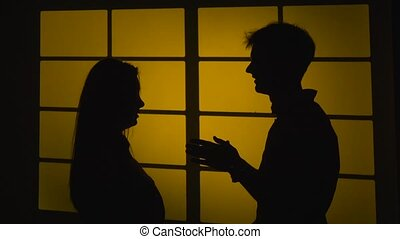Fight in a relationship Silhouette. Slow motion. Close up