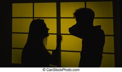 Conflict in the pair. Girl screams. Silhouette. Slow motion. Close up