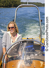Young Woman Girl in Power Boat at Sea