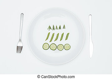 Top view of cucumber, rosemary and asparagus on the plate...