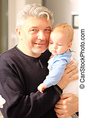 Newborn with his grandfather - Newborn baby with his...
