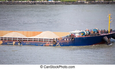 dry-cargo ship on river in china - dry-cargo ship on river...