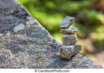 Balancing cairns in the forest in South Tyrol, Italy