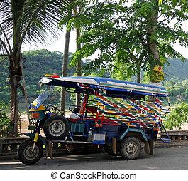 Luang Phabang -  a small taxi in  Luang Phabang lao