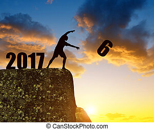 Concept New Year 2017 - Silhouette of man throws a six....
