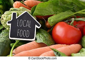 raw vegetables and text local food - closeup of a...