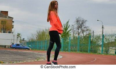 stylish sexy sporty girl in sportswear blond orange shape...