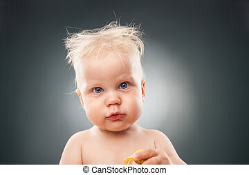 Funny kid making faces - Portrait of little baby with messy...