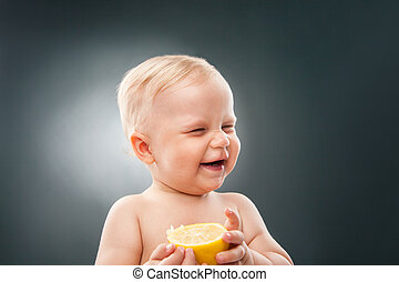 Smiling baby squinting eyes - Portrait of funny baby with...