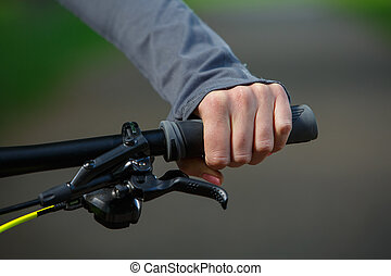 Woman hands on modern sport bike - Woman riding bicycle in...