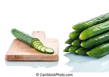 Cucumbers and slices on white background - Bunch of...