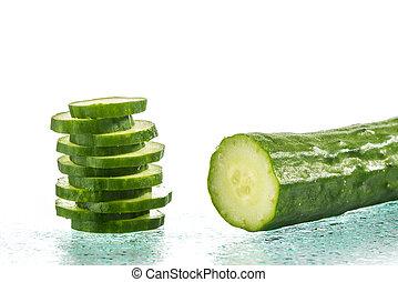 Fresh Cucumber slices on white background, reflection