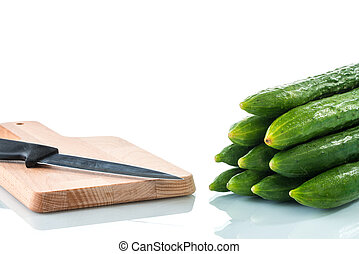 cucumber with the kitchen knife on white background