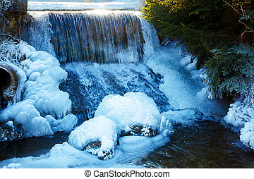 Winter scene with water falling from icy rocks - Winter...