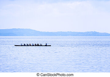 rowing boat with coxswain. success through team spirit and...