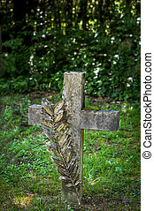 stone cross in a cemetery - a stone cross in a cemetery....