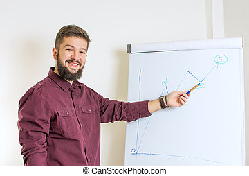 Bearded man presenting by the flipchart - Young bearded man...