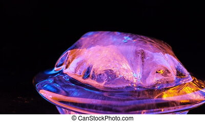 Ice melting. Time lapse - Time lapse of small piece of ice...
