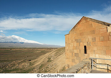 Ancient monastery in front of mountain - Part of ancient...