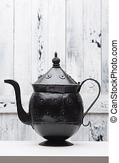 Aladin lamp silhouette - Ancient historic iron kettle for...