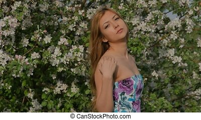 girl posing in sexy apple blossom - blonde girl smiling and...