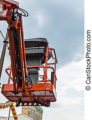 Oragne basket of the hydraulic crane for maintenance the...