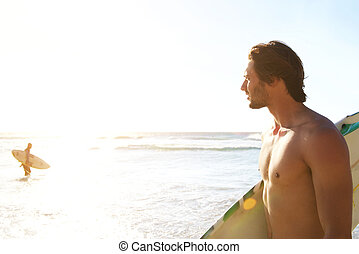 Surfer looking at sea