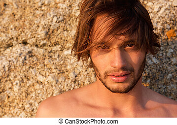 Handsome young shirtless man staring - Close up portrait of...