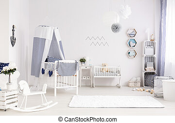 Baby room in marine style - White and spacious baby room...