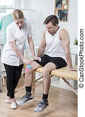 Man at physical therapist - Man with broken knee at young...