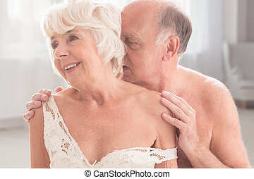 New love in old age - Romantic senior couple, man kissing...
