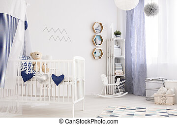 Nautical baby room - White baby room in marine design with...