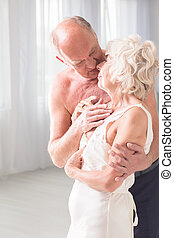 Sexuality in older age - Active senior man embracing his...