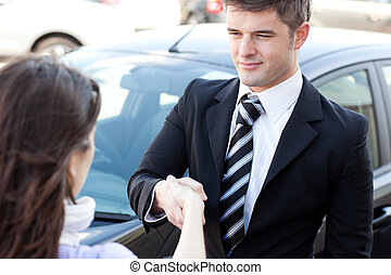 Self-assured businessman meeting his colleague in the street