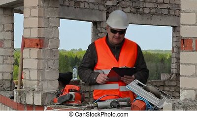 Builder checking and writing in the unfinished building